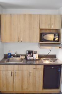 A kitchen or kitchenette at Coast High Country Inn