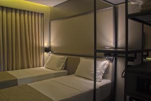 A bed or beds in a room at Slaviero Essential Campina Grande