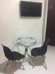 A television and/or entertainment center at Apartamento pertinho da UEM/Novo Centro