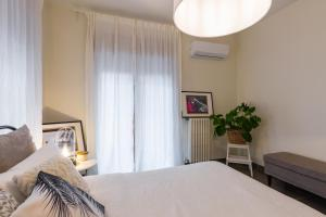 A bed or beds in a room at Starhost - CASA DEL CAPITANO