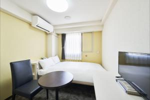 A television and/or entertainment center at FLEXSTAY INN Higashi Jujo