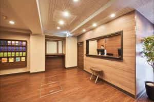 The lobby or reception area at FLEXSTAY INN Higashi Jujo