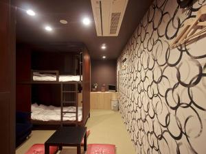 A bunk bed or bunk beds in a room at Hostel Kyoto Arashiyama
