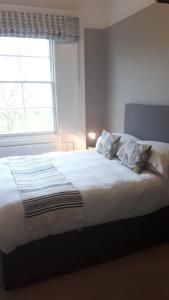A bed or beds in a room at The Priory