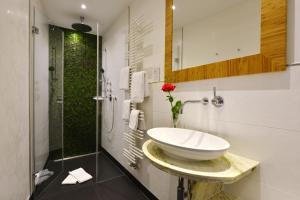 Ein Badezimmer in der Unterkunft Hotel Torbräu