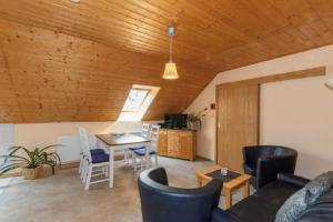 Ein Sitzbereich in der Unterkunft Ferienhof Bohg