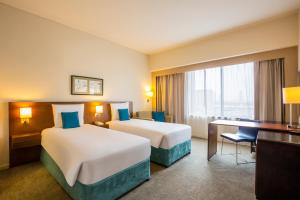 A bed or beds in a room at Novotel Deira City Centre