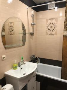 Ванная комната в Apartment Novaya Ilyinka 5
