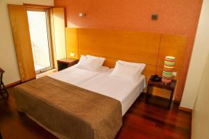 Uma cama ou camas num quarto em Hotel do Terco
