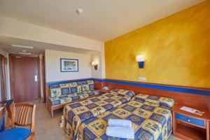 Säng eller sängar i ett rum på MLL Palma Bay Club Resort