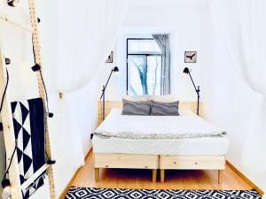 A bed or beds in a room at Hostel Crespo
