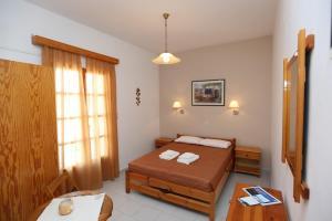 Ένα ή περισσότερα κρεβάτια σε δωμάτιο στο Θαλάσσια Θέα
