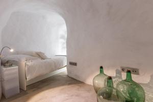 Cama o camas de una habitación en Casa Cueva Lujo Sacromonte con vistas Alhambra