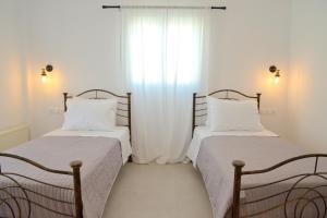 Ένα ή περισσότερα κρεβάτια σε δωμάτιο στο Veletas Rooms