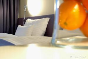 A bed or beds in a room at roomz Graz - Business Design Hotel