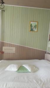 Кровать или кровати в номере Любимый Причал
