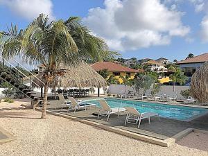 A piscina localizada em La Hasta Luxury Apartment Jan Thiel ou nos arredores