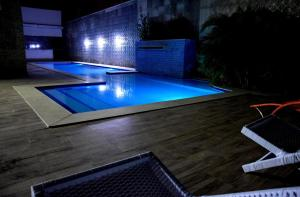 The swimming pool at or near Hotel Conterrâneo