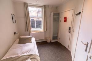 Кровать или кровати в номере Milling Hotel Mini 11