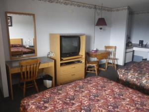 A television and/or entertainment center at Alcan Motor Inn