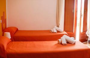 Letto o letti in una camera di St. Michele b&b