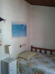 A bed or beds in a room at Casa Liberdade