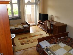 Telewizja i/lub zestaw kina domowego w obiekcie Apartamenty MTP