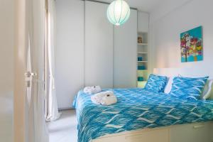 A bed or beds in a room at Calliope Corfu Apartments