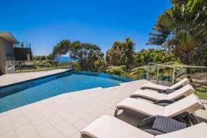The swimming pool at or near Rainbow Ocean Palms Resort