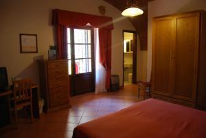 Телевизор и/или развлекательный центр в Hotel Fattoria Belvedere