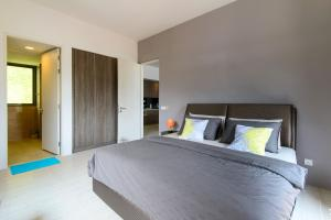 A bed or beds in a room at By The Sea Beach Front Apartment