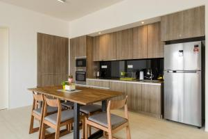 A kitchen or kitchenette at By The Sea Beach Front Apartment