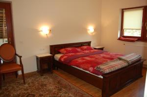 A bed or beds in a room at Pension Magnolia 2
