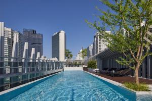 The swimming pool at or near Somerset Maison Asoke Bangkok