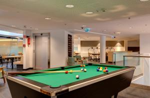 A pool table at MEININGER Budapest Great Market Hall