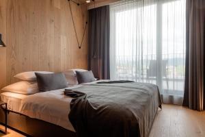 Łóżko lub łóżka w pokoju w obiekcie Hotel Nox