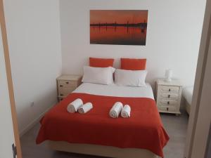 A bed or beds in a room at Alvor Guesthouse