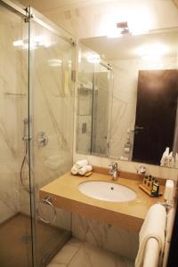 A bathroom at Grand Concerto Hotel