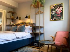 A bed or beds in a room at SleepWell Apartments Nowy Świat