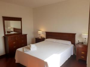 A bed or beds in a room at Views & luxury in Old Town