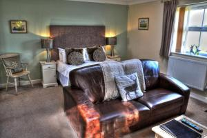 A bed or beds in a room at The White Horse View B&B