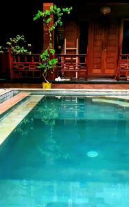 The swimming pool at or near Gili T Sugar Shack