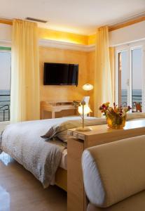 Letto o letti in una camera di Hotel Jasmin