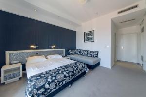 Voodi või voodid majutusasutuse Vile Oliva Hotel & Resort toas