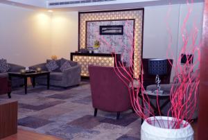 Uma área de estar em Grand Plaza - Qurtubah