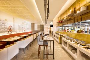A restaurant or other place to eat at Radisson Jaipur City Center