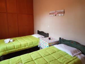 Кровать или кровати в номере CorfuGrace