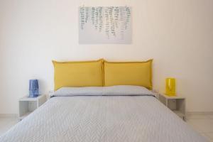 A bed or beds in a room at La Casa Sul Corso