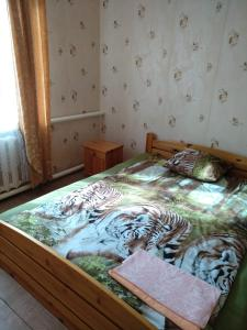 A bed or beds in a room at Viesnīca Piedruja