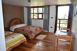 A bed or beds in a room at CasaNostra Choquequirao